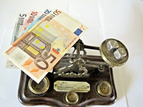 banknotes on scales